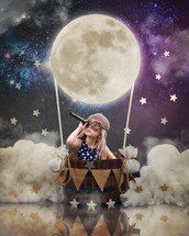 a child in a hot air balloon with a telescope