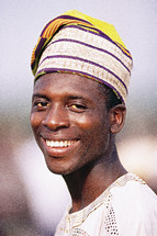 Happy African man in traditional garments {Also try search for 'Ethnic Faces'}