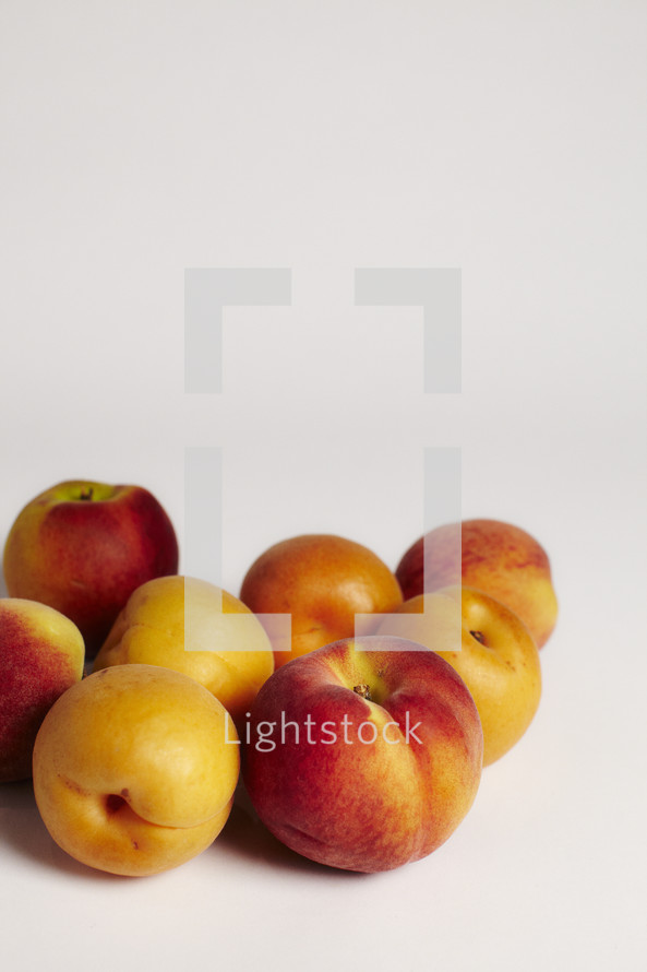 Group of peaches isolated on white