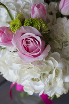 pink and white flowers in a bouquet