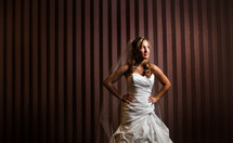 Bride poising in front of striped wall