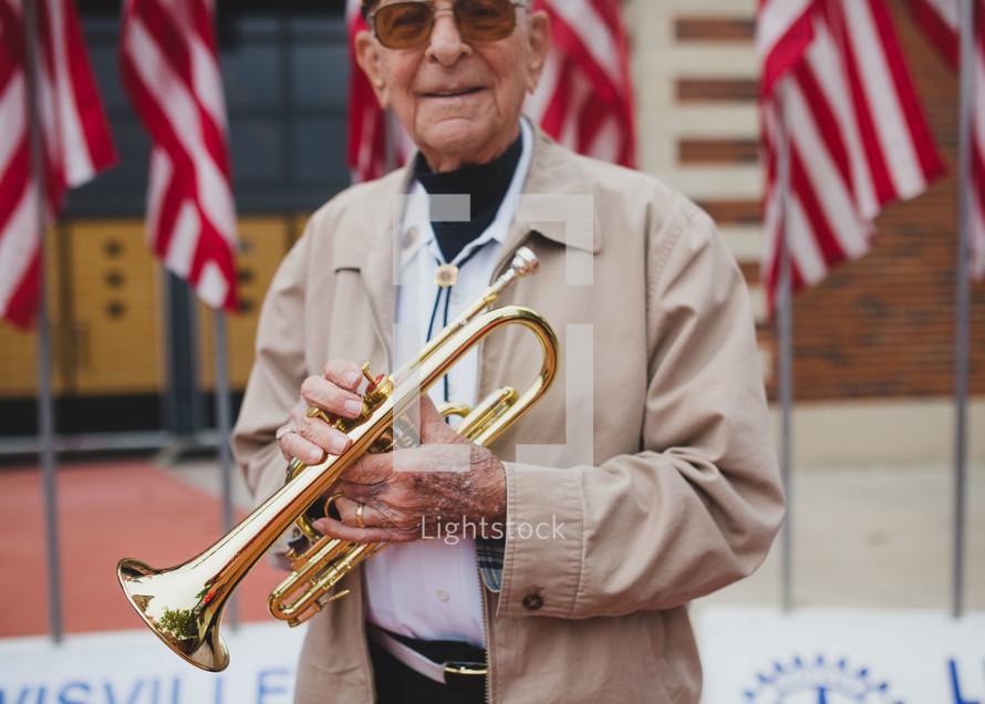 A Veteran playing a trumpet to honor fallen soldiers