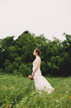 A bride standing in a field