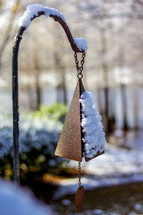 snow on a wind chime