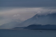 Early morning light over coastal mountains and clouds