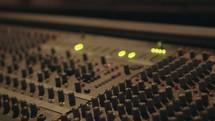 lights glowing on a soundboard