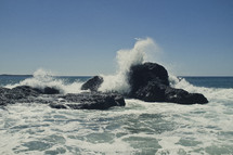 Waves crashing on the rocks in the ocean