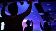 hands raised and song during a worship service