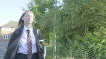 Senior school girl walking to school themes of education routines childhood