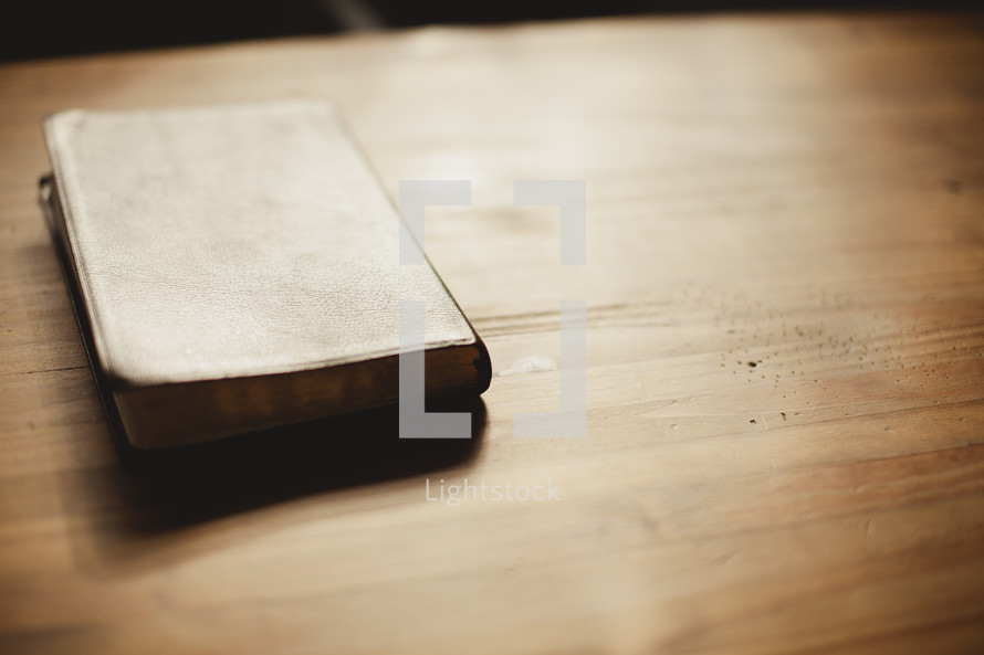 Bible sitting on a table