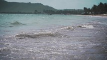tide washing onto an island shore