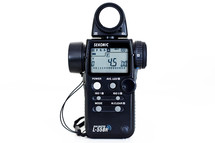 Sekonic L-558R light meter against white background photography gear equipment