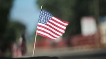 American flags along a curb on a parade route