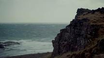 jagged cliffs along a shore