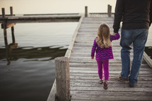 Father and daughter on boardwalk