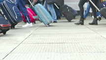 people walking with luggage in an airport
