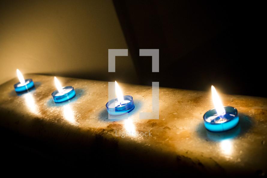 Tea candles burning