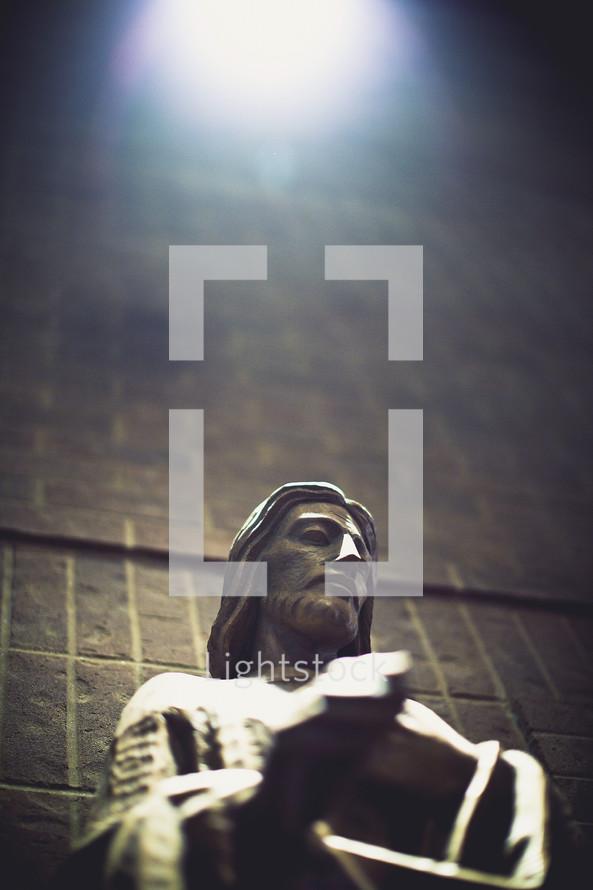 sunlight on a statue of Jesus