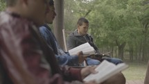 young men discussing scripture on a cabin porch