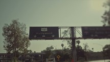 Freeway sign that says Hollywood