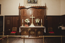 A Church altar with Cross and candles