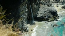 waterfall flowing onto a beach