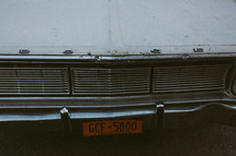 license plate on the front of an old Dodge