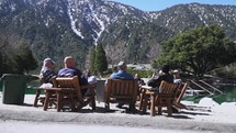 mountain view and men's group discussing scripture outdoors