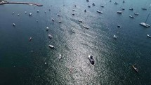 Boats dotting the harbor shot from above.