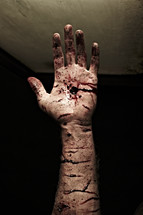 The wounded and nail-scarred hand of Jesus