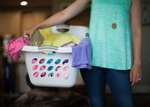 a woman holding a laundry basket