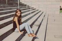 teen girl sitting on steps