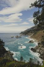 Inlet of ocean water between two moutain cliffs.