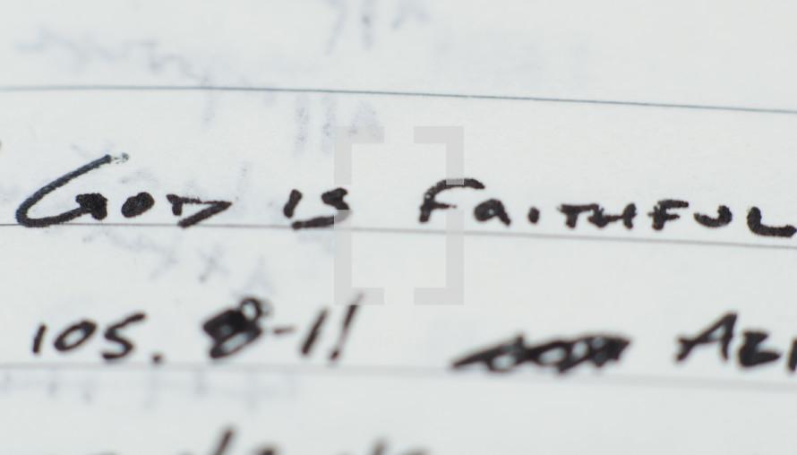 """God is faithful"" written in ink on notebook paper."