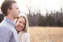 young couple in love standing outdoors