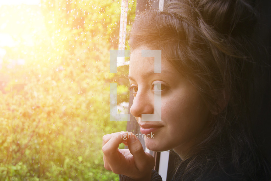 face of a young woman illuminated by sunlight