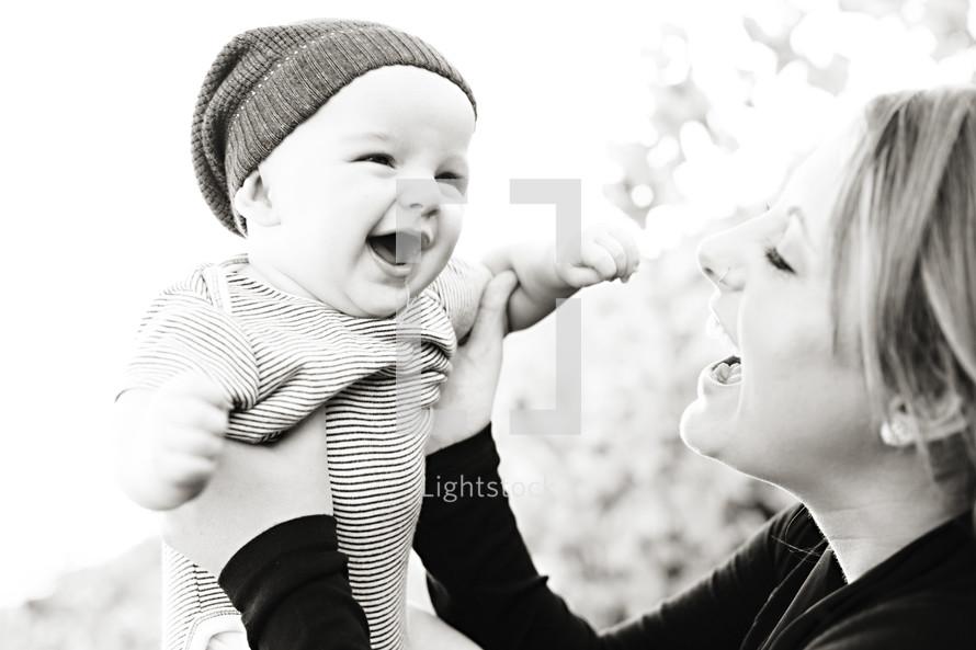 mother holding her happy smiling infant son joy parent mom