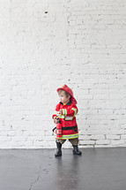 toddler in a fireman costume