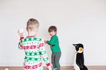 kids in Christmas pajamas through fake snowballs