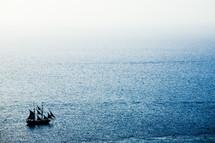 A ship sailing on a calm sea