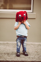 toddler boy in a red dog knit hat