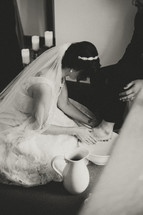 a bride washing her grooms feet