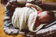 a newborn baby in a carseat