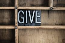 word give in blocks on a bookshelf