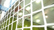 basketball going into a net