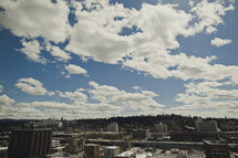 Billowing clouds in a blue sky over the city