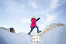 a girl playing in snow