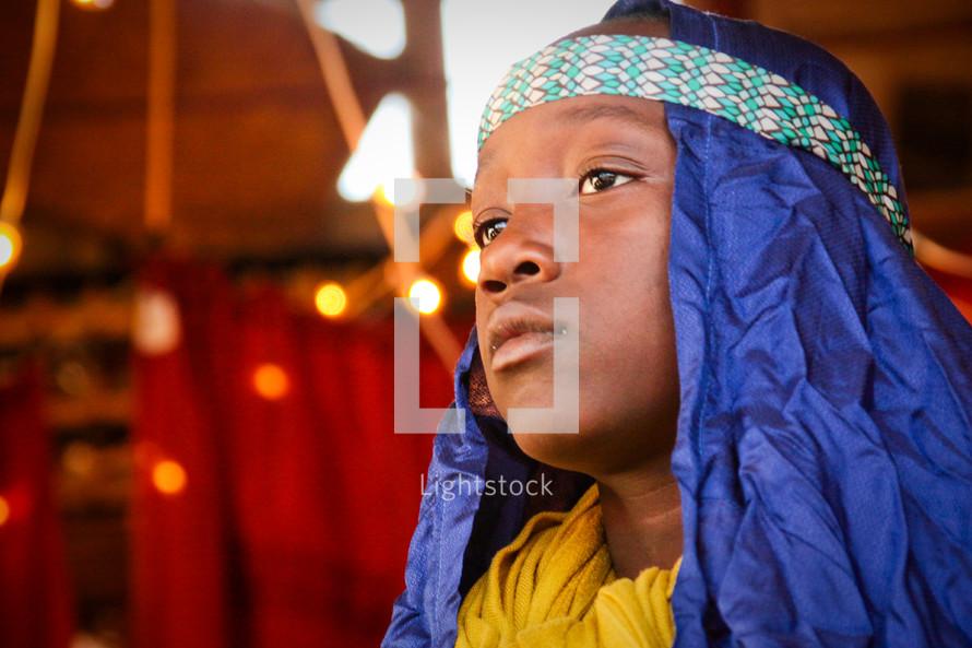 a child in a live nativity scene