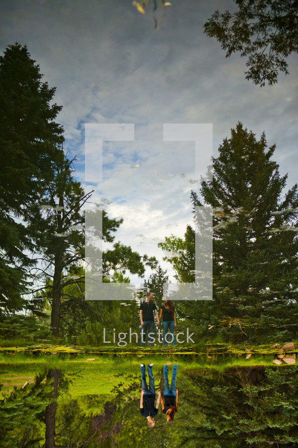 Couple walking through forest