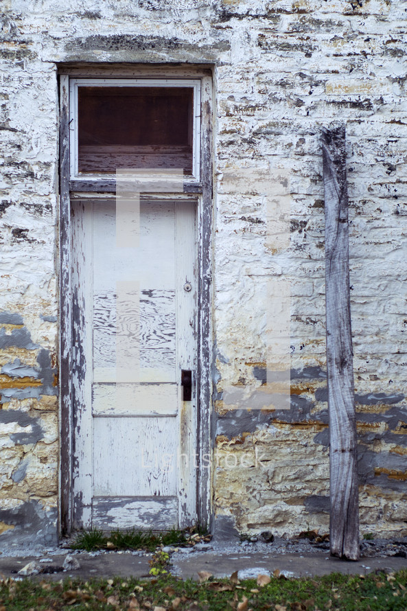 door on an old building with peeling paint